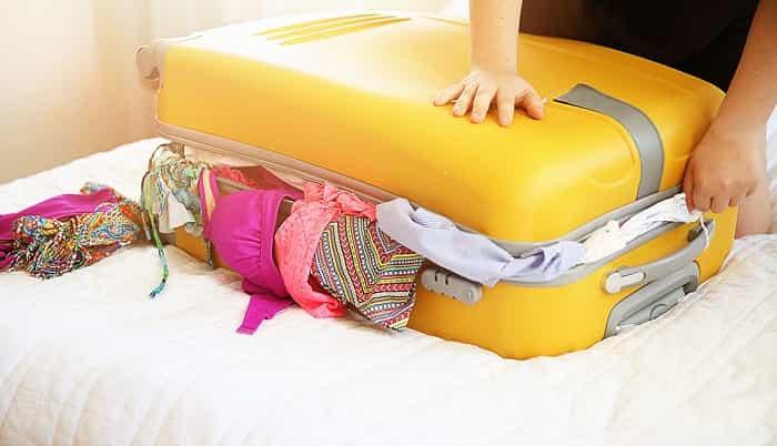 Wear your heaviest or bulkiest items