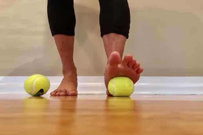 Roll them on a tennis ball